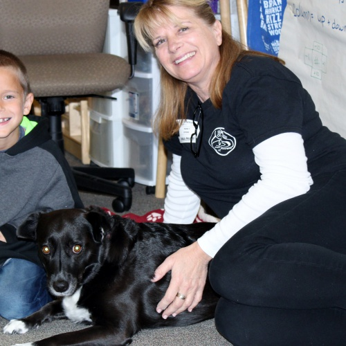 Second graders meet author, dog star of