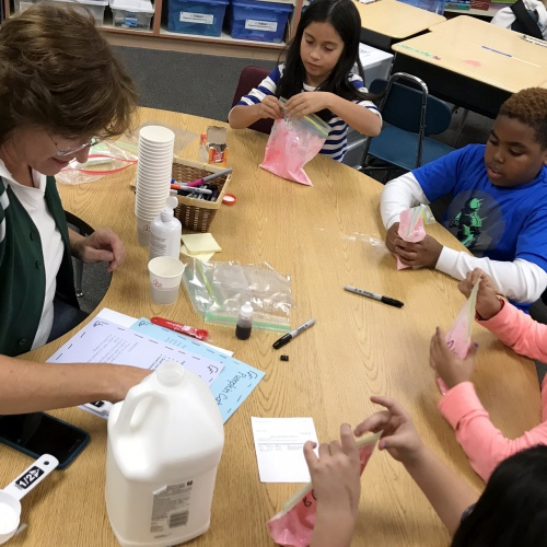 STEM Club using dry ice, making slime, 11.,2017