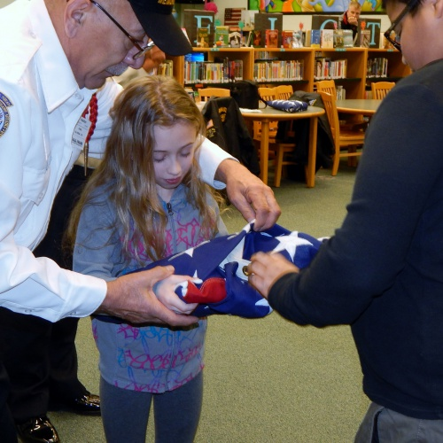 Veteran teaching students about the American flag, 02.22.2018