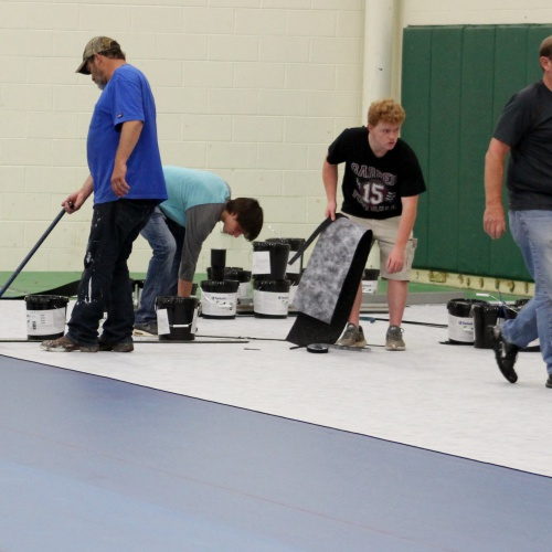 UPDATE: Installing new flooring in field house, 06.06.2018