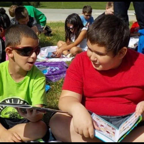 Fifth graders read to first graders to say goodbye summer, 09.21.2018