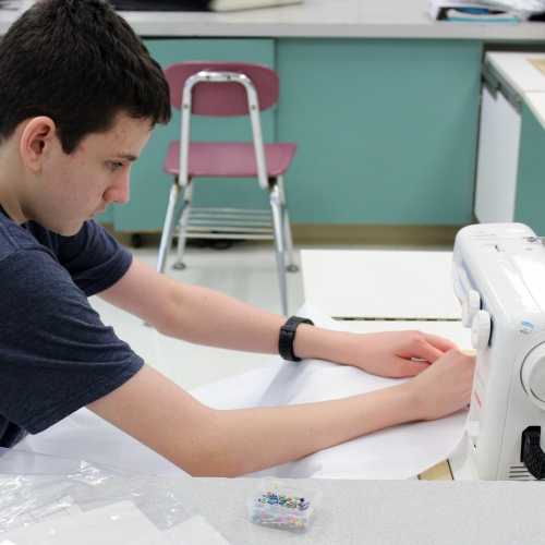 Seventh graders sew aprons in family and consumer science class