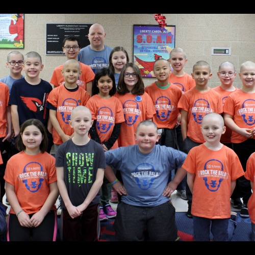 Students, staff show off shaved heads as fundraiser to fight childhood cancer