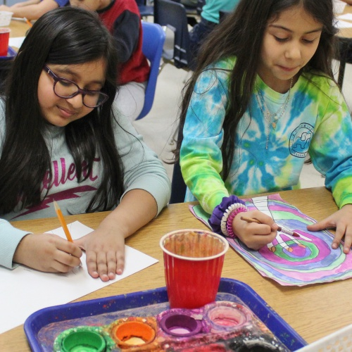 Third grade creates paintings using complementary colors in art class, 01.28.2020