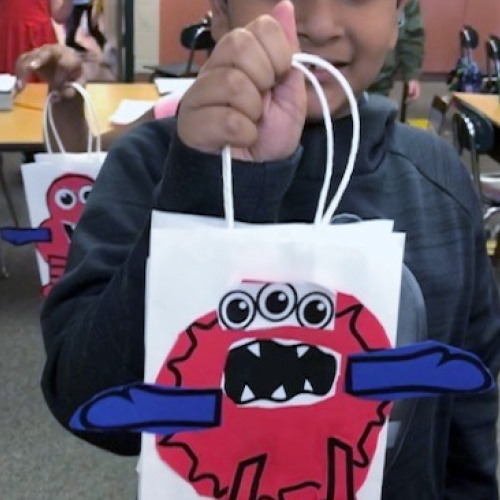 Second graders make Monster Bags, learn about money