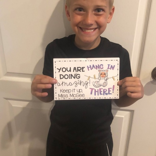 Third grade teacher Marissa McGee sends postcards to students during remote learning