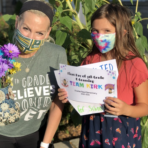 Fifth-grade teachers welcome students with supply bags
