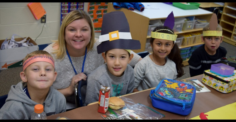 First graders enjoy Thanksgiving lunch, Freedom Elementary School