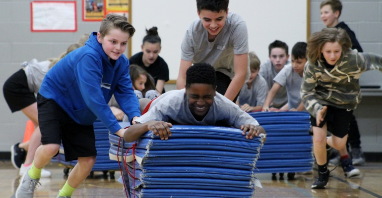 Heritage Grove Middle School students master bobsledding in physical education class