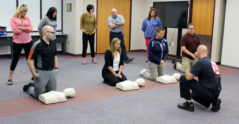Building administrators learn CPR, July 2018