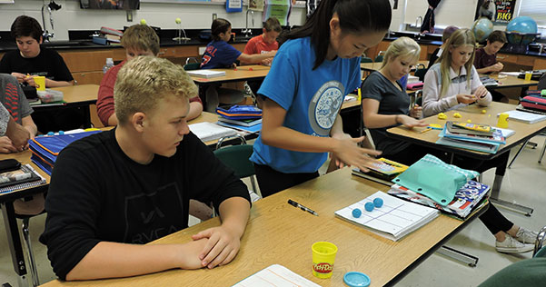 students participate in a project to learn about the planets using play-doh
