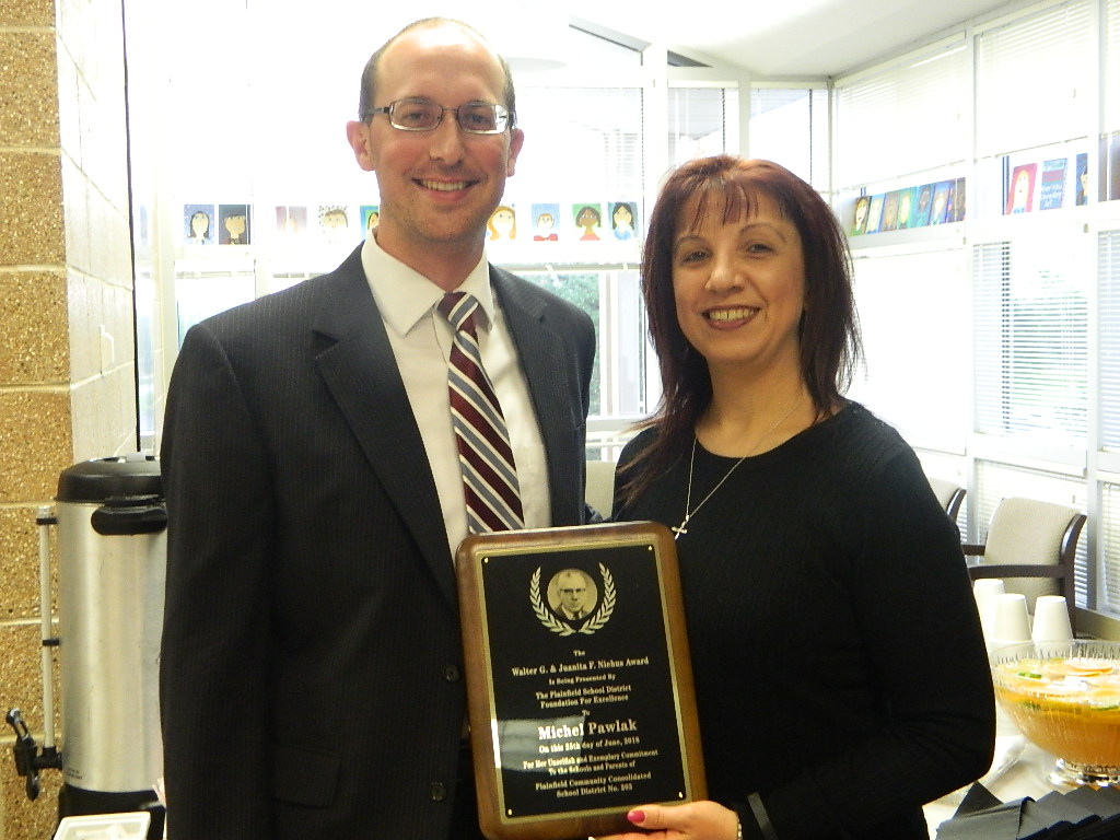 Foundation for Excellence Chair Matt Starr presented the 2018 Niehus Award to PEHS guidance counselor Michel Pawlak.