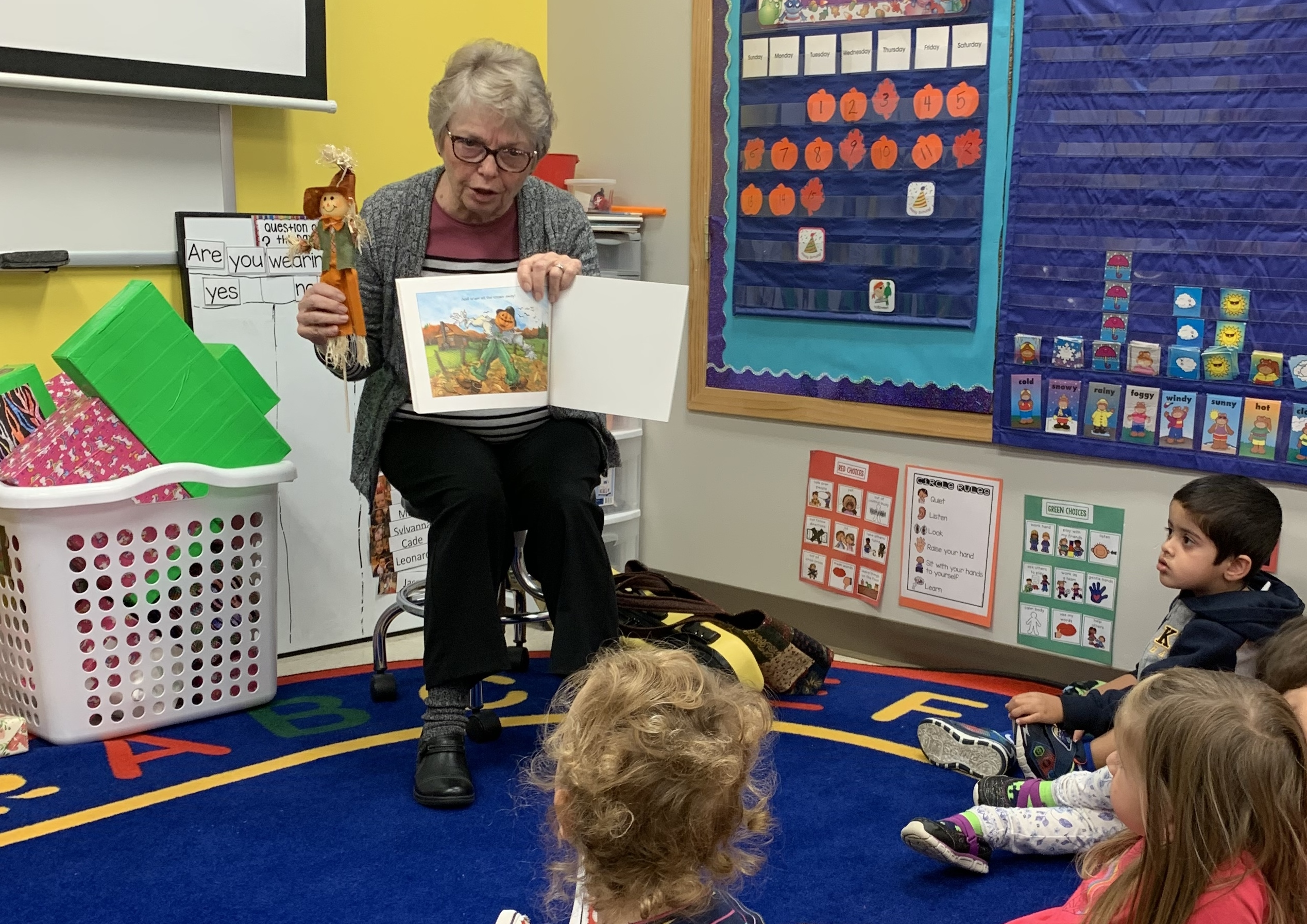 Ina Brixey, retired District 202 kindergarten teacher, reads a book to preschool students at the Ina Brixey Center in October 2019. The center opened in August 2019 and was given a Gold Circle of Quality from ExceleRate Illinois. The rating grades preschool facilities on a variety of items including teaching methods and physical space setup.