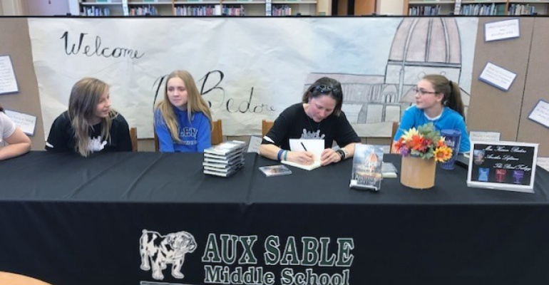 Aux Sable Middle School band director author Karen Bedore signs her book for students