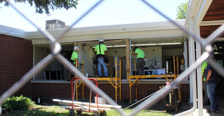 Crews install new windows at Crystal Lawns Elementary School